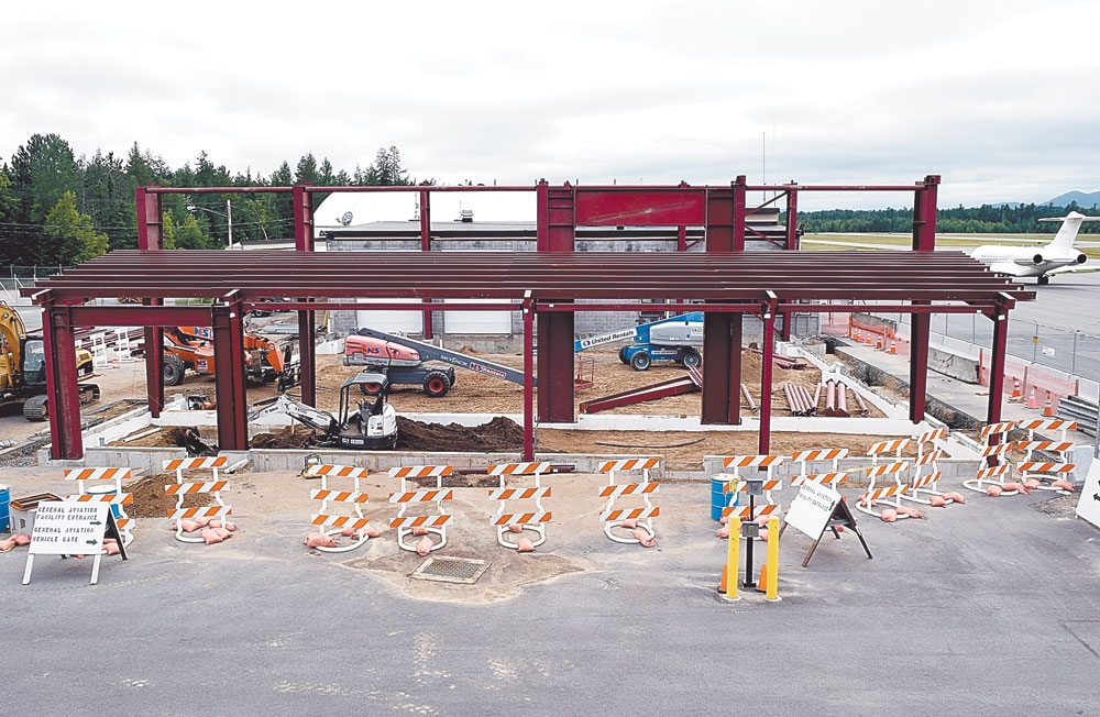 A crew from Con Tech Building Systems of Gouverneur started work in May on a $1.7 million expansion of the Adirondack Regional Airport's facility for snow removal equipment, aircraft rescue and firefighting. (Enterprise photo — Chris Knight)
