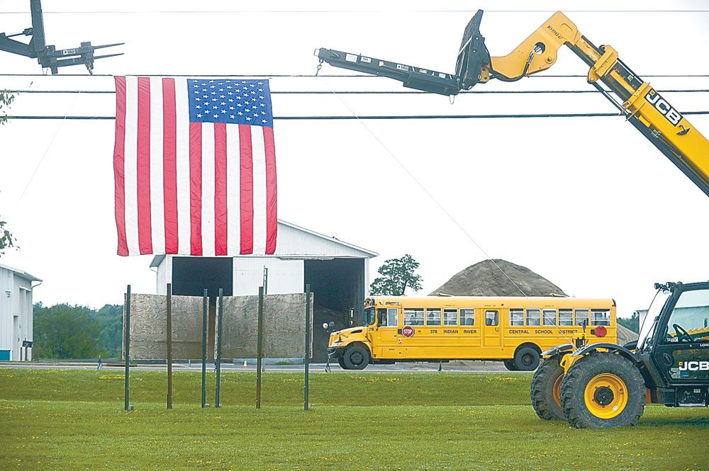 Family members load onto shuttle busses at Indian River High School to attend the calling hours for fallen state Trooper Joel Davis on Friday at Fort Drum. (Photo provided — Daytona Niles, Watertown Daily Times)