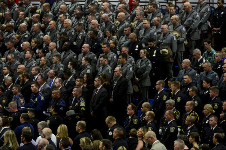 Law enforcement officers from around the county come to support the family and friends of fallen trooper Joel Davis as they say goodbye during a funeral service on Saturday at Fort Drum. (Photo provided — Daytona Niles, Watertown Daily Times)