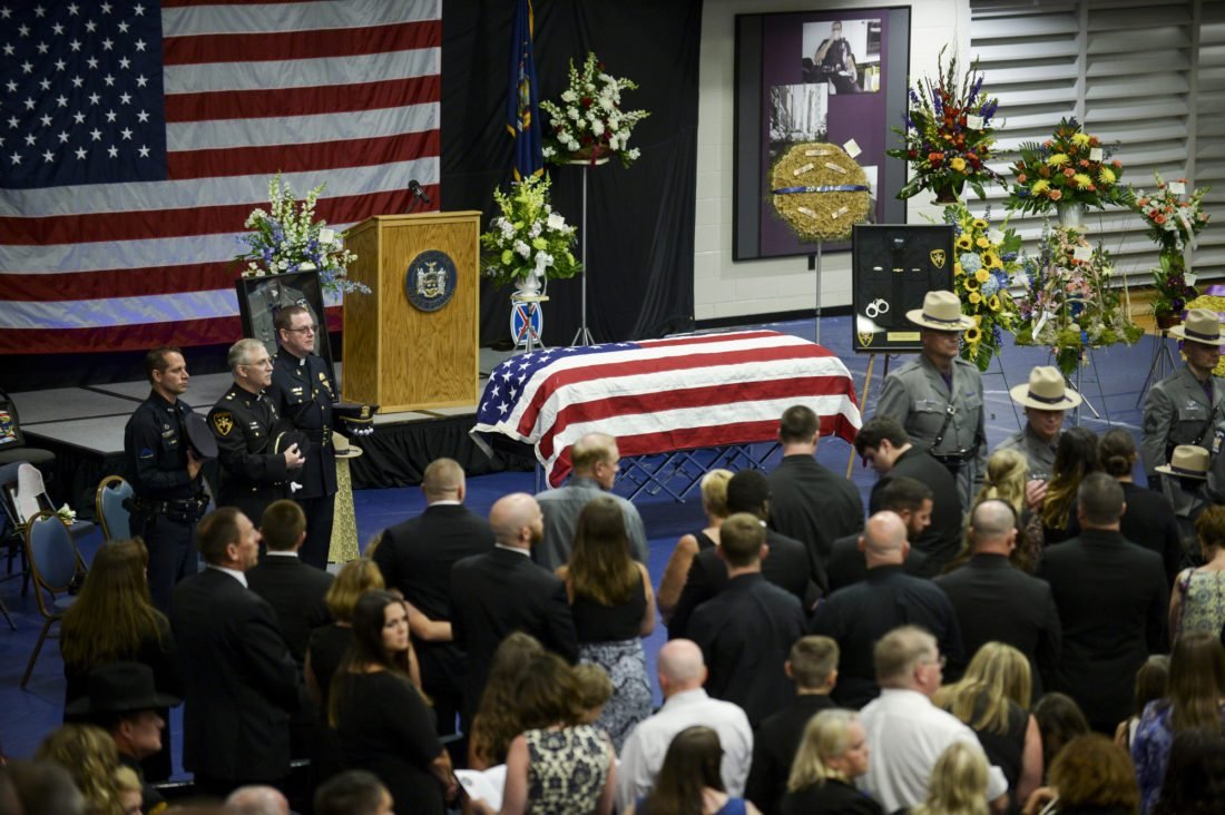 Family and friends come together to say goodbye to fallen trooper Joel Davis during a funeral service on Saturday at Fort Drum.  (Photo provided — Daytona Niles, Watertown Daily Times)