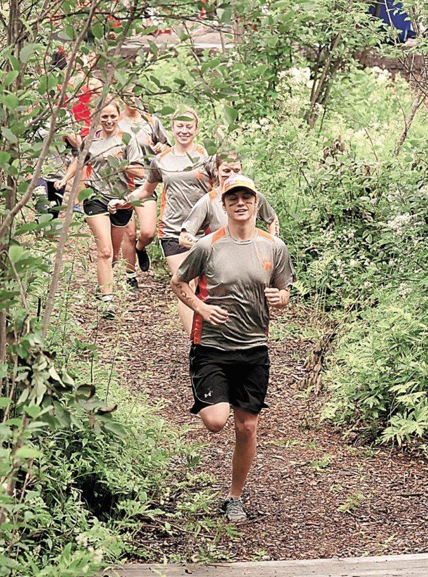 Racers begin their 4-plus mile trek through the wetness and mud during Satrurday's Warrior Run in Tupper Lake. (Enterprise photo — Lou Reuter)