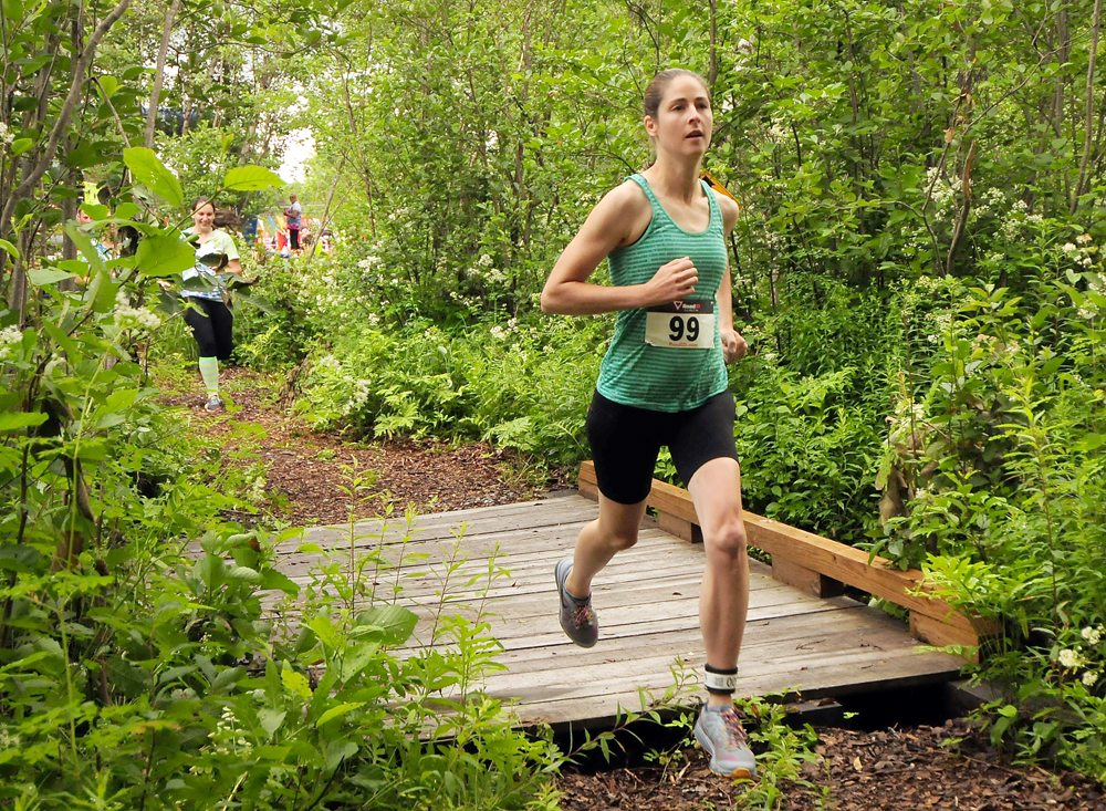 Susan Schofield distances herself from the rest of the pack just after leaving the starting line in Saturday's Warrior Run in Tupper Lake. After settling for a runner-up result a year ago, Schofield broke through with a victory as the race's fastest finisher overall. (Enterprise photo — Lou Reuter)