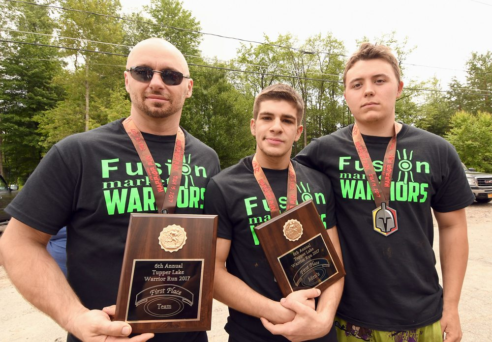 Men's champion Myckael Colon, center, is flanked by teammates Randy Beckwith, left, and Dylan Kilner, who represented Saranac Lake's Fusion Market. (Enterprise photo — Lou Reuter)