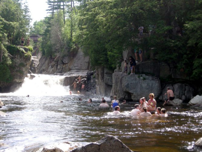 People swim and, at left, prepare to jump from cliffs at the Flume in Wilmington in July 2011. (Enterprise photo — Richard Rosentreter)
