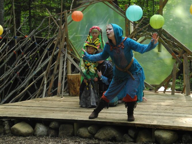 "Performers in the Pendragon Theatre's ""A Midsummer Night's Dream"" practice the play in the woods of Dewey Mountain Recreation Area, where it will be preformed throughout the month. (Enterprise photo — Aaron Cerbone)"