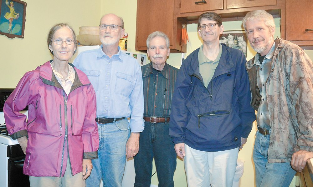 From left, Patience Whitman, Glenn Arnold, Jack Carney, Fred Balzac and Walt Linck pose for  a photo in late June following a discussion about national and local politics in an attempt to finalize the platform for Grassroots Independents of the North Country. (Enterprise photo — Antonio Olivero)
