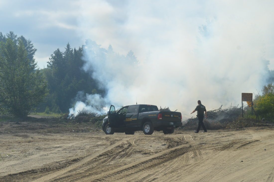 State Environmental Conservation police were on the scene of a brush fire this morning at the North Elba Tranfer Station in Lake Placid. The fire has been burning since Thursday night.  (Enterprise photo — Antonio Olivero)