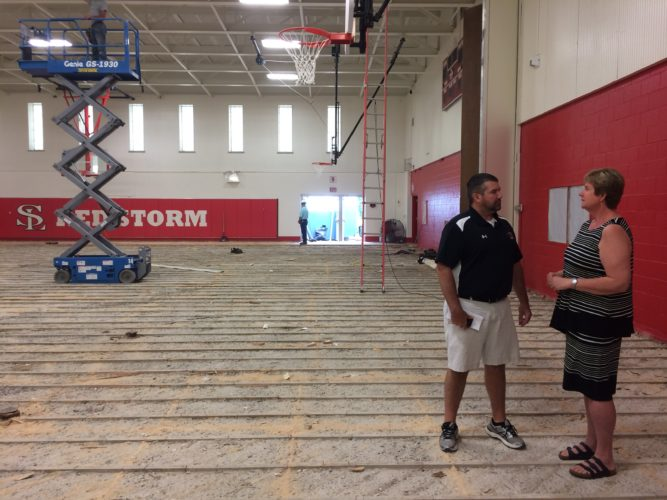 Saranac Lake High School Principal Josh Dann stands inside the gym, which is being renovated currently. (Enterprise photo — Chris Knight)