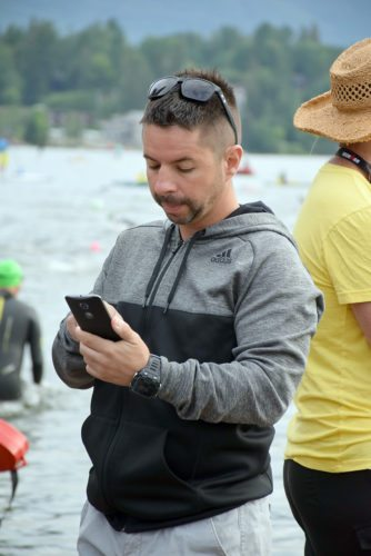 Dan Forgett uploads photos from his phone for the Ironman live blog during Sunday's race in Lake Placid. Forgett was tasked with following the leaders to provide live photos, video and status updates. (Enterprise photo — Justin A. Levine)