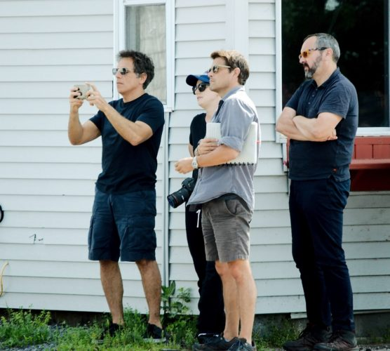 Actor/director Ben Stiller uses his cell phone Saturday in Malone while he and a film crew complete research for the upcoming Showtime series about the 2015 Dannemora prison break. Seen at far right is Emmy award-winning film producer Scott Hornbacher. (Photo provided — Jason Cerone)