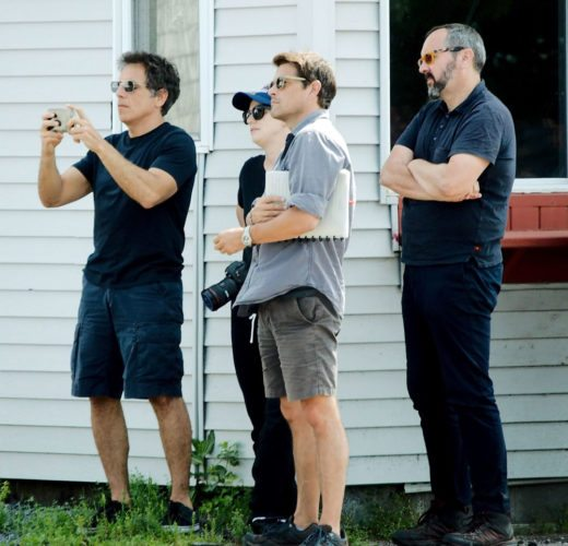 Actor/director Ben Stiller, left, uses his cellphone Saturday in Malone while he and a film crew complete research for the upcoming Showtime series about the 2015 Dannemora prison break. At far right is Emmy award-winning film producer Scott Hornbacher. (Photo provided — Jason Cerone)