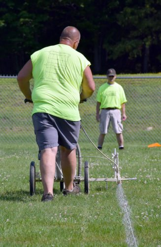 Chris Blanchard, left, and Jeff Letson line one of the rugby fields at Petrova Middle School in preparation for this weekend's Can-Am Rugby Tournament. (Enterprise photo — Justin A. Levine)