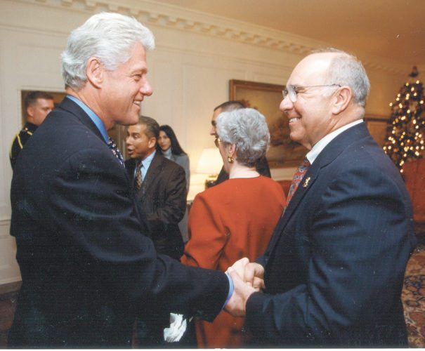 President Bill Clinton shakes hands with then-Franklin County Democratic Committee Chairman and Harrietstown Supervisor Joe Pickreign of Lake Clear during a visit to the White House in December 2010. (Photo provided)