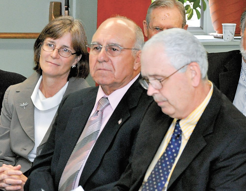 Franklin County Democratic Committee Chairman Joe Pickreign sits flanked by, left, then-state Department of Environmental Conservation Region 5 Director Betsy Lowe and, right, North Elba Supervisor Roby Politi during a July 2010 speech by Gov. Andrew Cuomo at the Saranac Lake Adult Center. (Enterprise file photo — Mike Lynch)
