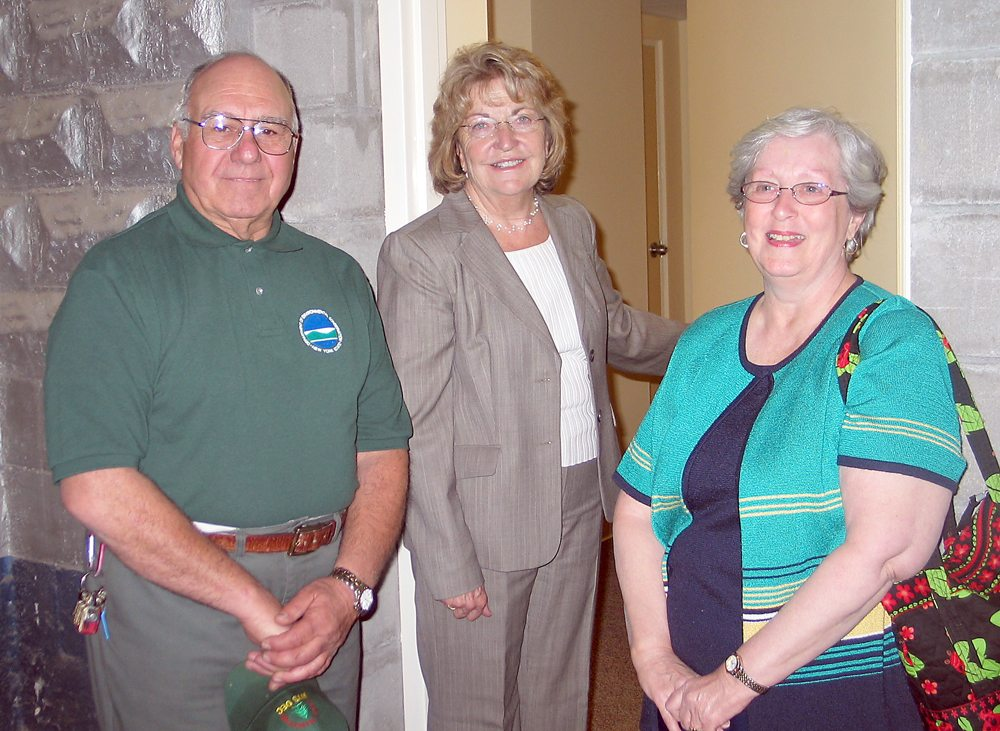 Showing Republicans and Democrats can work together, Franklin County Democratic Committee Chairman Joe Pickreign, left, stands with GOP state Sen. Betty Little and Shirley Pickreign in the basement of the Saranac Lake Adult Center in 2009. Little helped secure state funds to renovate the basement of the center into a wellness facility. (Enterprise file photo — Nathan Brown)