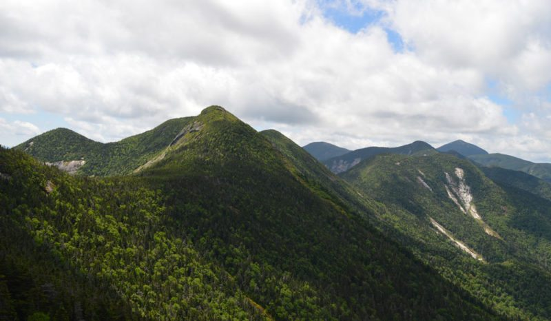 "The Great Range is seen July 2 from the summit of Armstrong Mountain, facing southwest with Gothics just left of center. A Saranac Lake couple twice encountered Ralph ""Skip"" Baker on the State Range Trail in the col between Gothics and Armstrong at left. (Enterprise photo — Antonio Olivero)"