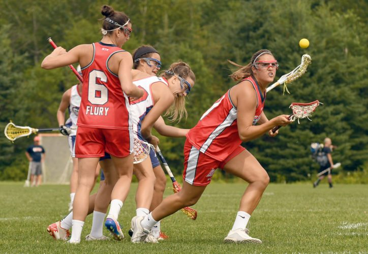 Nicole Poli of Boston reaches out from a crowd of players to corral the ball during Wednesday's UWLX championship game held during the 44th annual Lake Placid Summit Classic lacrosse tournament. (Enterprise photo — Lou Reuter)