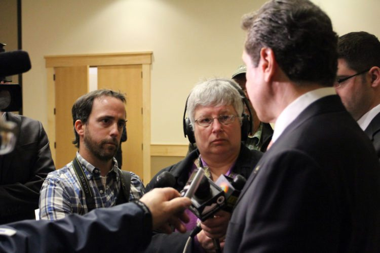 Enterprise Senior Staff Writer Chris Knight, far left, and other reporters ask questions of Gov. Andrew Cuomo in November 2013 at the Conference Center at Lake Placid. (Enterprise file photo)