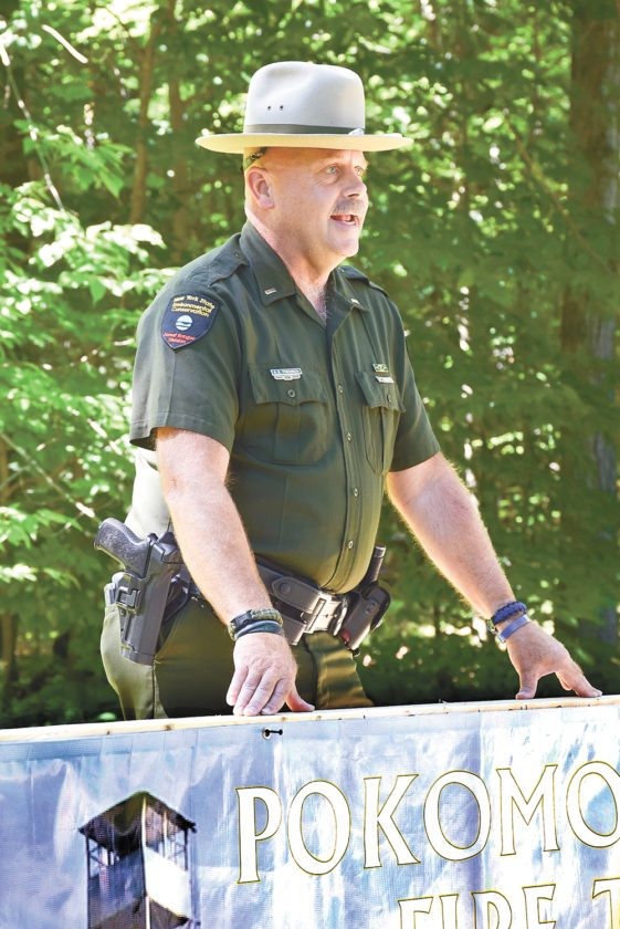 Forest Ranger Gary Friedrich speaks at the 100th anniversary of the Poke-O-Moonshine fire tower. Friedrich has been involved with the tower and restoration effort for more than 20 years.  (Enterprise photo — Justin A. Levine)