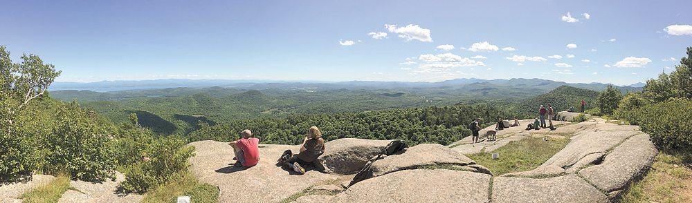 This view from the summit of Poke-O-Moonshine in Chesterfield includes the Green Mountains, Lake Champlain, the High Peaks and Whiteface Mountain.  (Enterprise photo — Justin A. Levine)