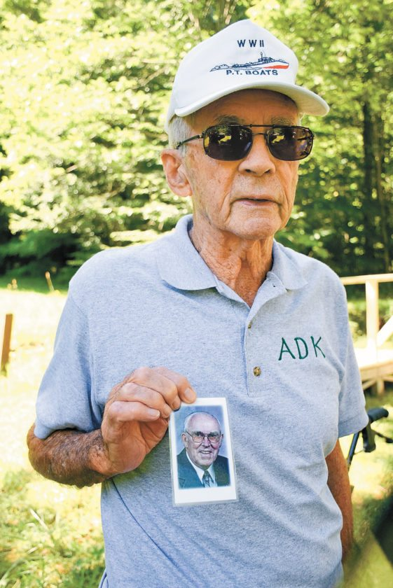 John Mussen was a fire observer on Poke-O-Moonshine and has climbed the mountain an estimated 700 times. He climbed it again on his 91st birthday last Friday, and carried this photo of his friend and former forest ranger Mike Thompson to the summit. (Enterprise photo — Justin A. Levine)