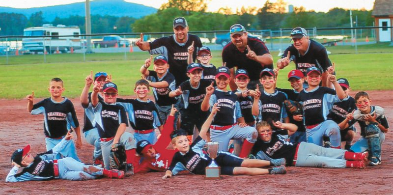 Players and coaches from Shaheen's IGA celebrate their championship victory Friday, July 28 in boys minors (9-10 year olds) baseball at the Tupper Lake Municipal Park. Shaheen's beat the Kiwanis Club of Saranac Lake squad 18-11 to claim its second title in a row. The Shaheen's players are: Wyatt Godin, Kyler Mclain, Luke Robillard, Grant Bencze, Logan Flagg, Philip Lindsey, Mason Fowler, Cooper Cuttaia, Brady Skiff, Luke Domine, Colin Bencze, Sean Schaffer, Lucas Stevens, Bryce Hutt, Sawyer Dewyea, Bauer Callaghan, Cohen Gerstenburger and Knaullyn Durfee. The team is coached by Marshall Godin, with assistant coaches Mark Robillard and Gene Flagg. (Photo provided)