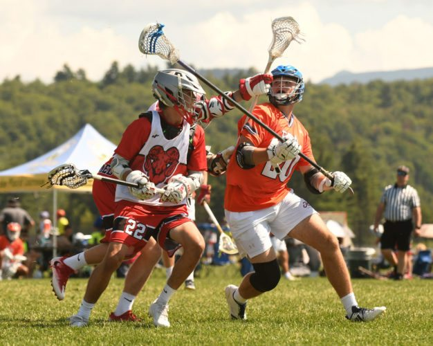 Players from the FCA National High School team and 3rd National battle for possession during Tuesday's boys scholastic Gold division game at the Lake Placid Summit Classic lacrosse tournament in Lake Placid. (Enterprise photo — Lou Reuter)