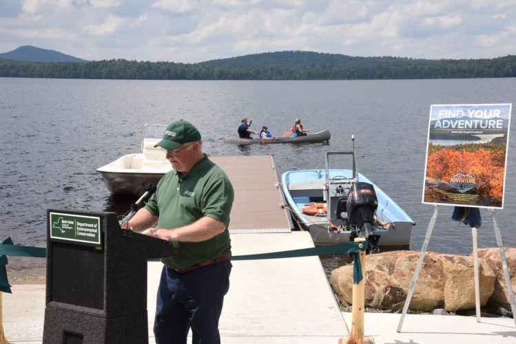 DEC Region 5 Director Bob Stegemann speaks at a ceremony last week that officially recognized the opening of a new boat launch at Meacham Lake Campground south of Malone. (Photo courtesy of the NYSDEC)