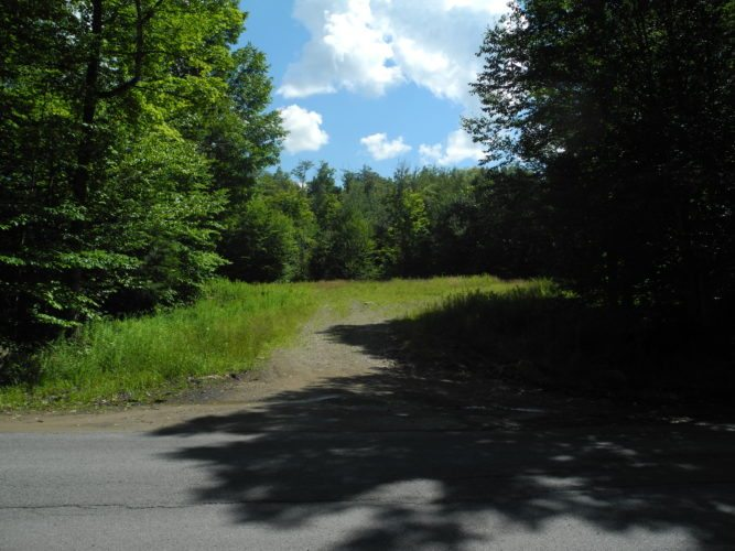 """Permits have been issued to construct Pond Road, which would branch off of Lake Simond Road and lead to the Adirondack Club and Resort's 18 """"great camp"""" building lots in Tupper Lake. (Enterprise photo — Aaron Cerbone)"""