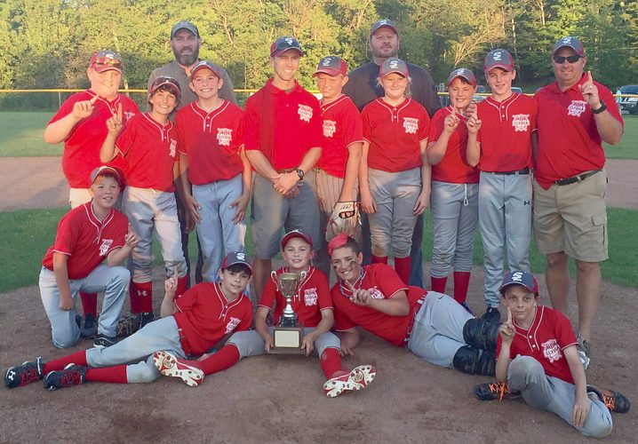Amerigas claimed the local youth baseball boys majors championship on July 29 at Rotary Field in Saranac Lake, defeating Elks Club by a score of 11-4. Amerigas finished with an 8-5 overall record this season. Pictured celebrating their title are, front row from left, Brennan Rutledge, Quinton Murgia, Gabe Wilson, Cedar Rivers and Ian Barry. Middle row: Austin Barry, Sam Ash, Evan Willett, assistant coach Bill Wilson, Cayden Heading, Kylee Meyer, Ethan Dukett, Brady Roberts and head coach Daryl Roberts. Back row: assistant coaches Shane Ash and Bob Meyer.  (Photo provided)