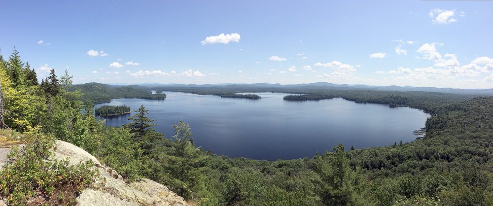 Lake Lila and the central Adirondacks are seen from these cliffs on Mount Frederica in the William C. Whitney Wilderness area between Long Lake and Tupper Lake. (Enterprise photo — Justin A. Levine)