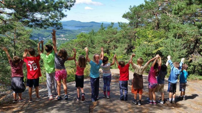 Students from Kids R Us Early Learning Center in Saranac Lake stand together hand-in-hand after a hike to the top of Mt. Baker.  (Photo provided)