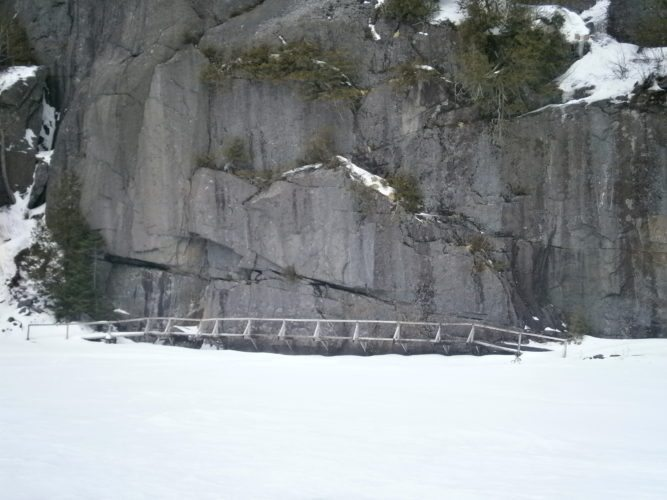 The Hitch-Up-Matildas, seen here in March 2014, is a set of boardwalks bolted into the side of a cliff that dives in Avalanche Lake in the High Peaks Wilderness Area. (Enterprise photo — Justin Levine)