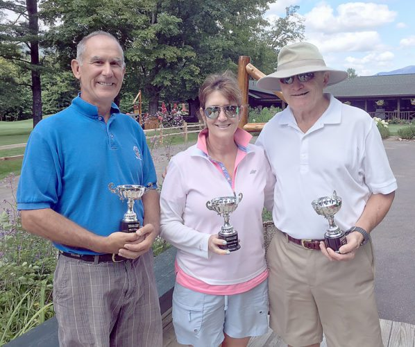 From left, Steve Bell, Deb Ward and Brendan Gnall pose for a photo Sunday after being crowned as golf champions at the Whiteface Club and Resort in Lake Placid. Bell and Gnall finished tied for the men's title and were declared co-champions by PGA professional J. Peter Martin. Ward captured the ladies club championship. (Photo provided)