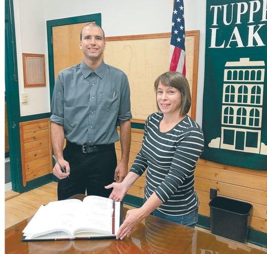 Brandon Duchaine was sworn in Friday as the newest member of the Tupper Lake Police Department. He is pictured with Tupper ake village Clerk Mary Casagrain. (Photo provided — TupperLake  Police Department)