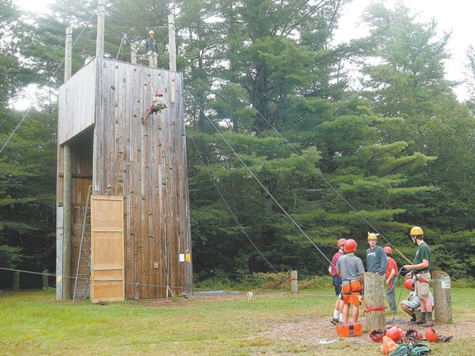 A Boy Scout descends a rappelling wall at Massawepie Scout Camps. (Enterprise photo — Dana Hatton)