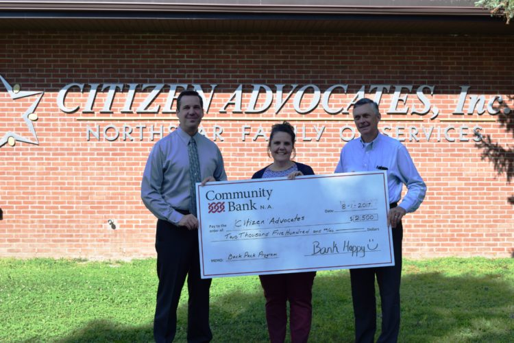 Community Bank, N.A. recently made a $2,500 donation to the Backpack Program, sponsored by Citizen Advocates.  Presenting the check to Citizen Advocates CEO Dean Johnston, left, were Stacey Brunell, branch manager for the bank's West Main Street location in Malone, and Craig Stevens, Vice President of Commercial Banking.  The Backpack Program provides healthy meals on weekends to local eligible youth in grades kindergarten through six during the academic year.  Now in its sixth year of operation, program sponsors are gearing up for their major fundraising event, The Taste of Malone Dinner.  The dinner is scheduled to take place on Wednesday, Oct. 4 at the Malone Golf Club.  To learn more or support the program, call  518-651-2760. (Photo provided)