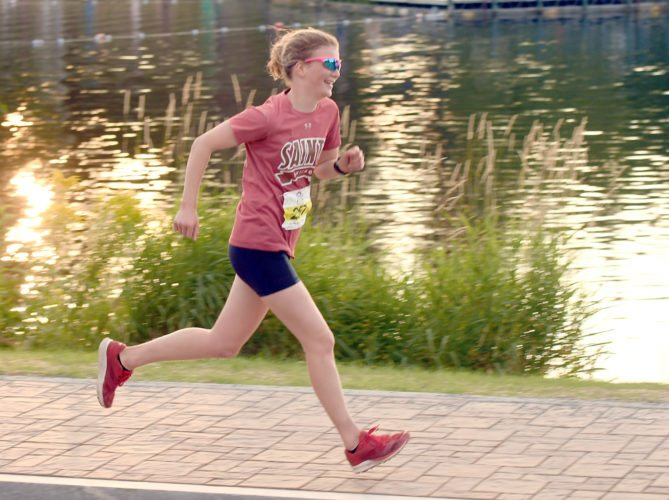St. Lawrence University senior Dana Hatton starts her 3-mile run during Monday's Mini-Triathlon in Lake Placid. (Enterprise photo — Lou Reuter)
