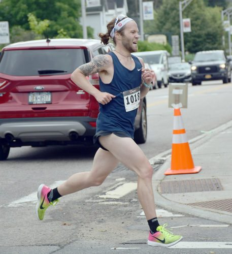 Josh LeBlanc, a Saranac Lake native, races to victory in Saturday's Olga Memorial Footrace in Saranac Lake, finishing the 6.2-mile course in 30 minutes, 12 seconds. (Enterprise photo — Justin A. Levine)