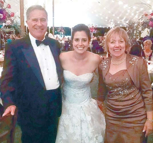 U.S. Rep. Elise Stefanik, center, poses at her wedding with Jan, left, and Barb Plumadore of Saranac Lake Saturday in a tent outside the Hall of Springs in Saratoga Springs. Jan, a retired judge, officiated the wedding ceremony. (Photo provided by Jan Plumadore)