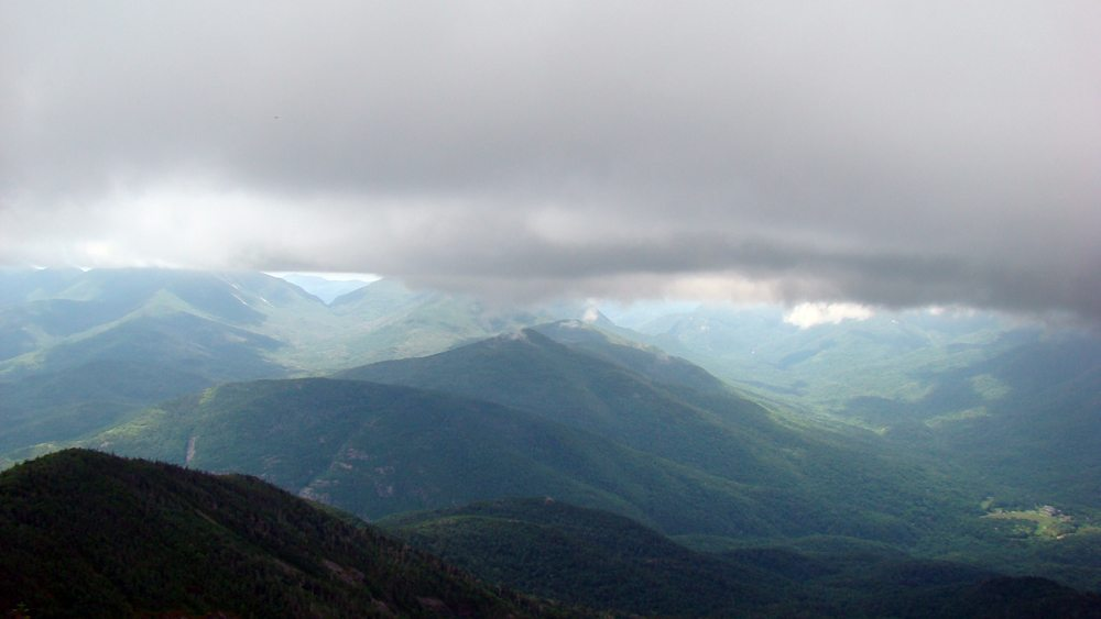 Low-lying clouds obscure the view from the top of Giant Mountain in St. Huberts as rain falls in the valley but not on the mountain summit. (Photo — Joe Hackett)