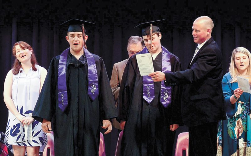 Long Lake Central School graduates Austin Pierce, left, and Ethan Bush are flanked by their graduation speaker Christian Wissler, a natural resource science teacher from BOCES, at their graduation in June. Bush and Pierce were the school's only two graduates in 2017.  (Photo provided — Nicole Curtin)
