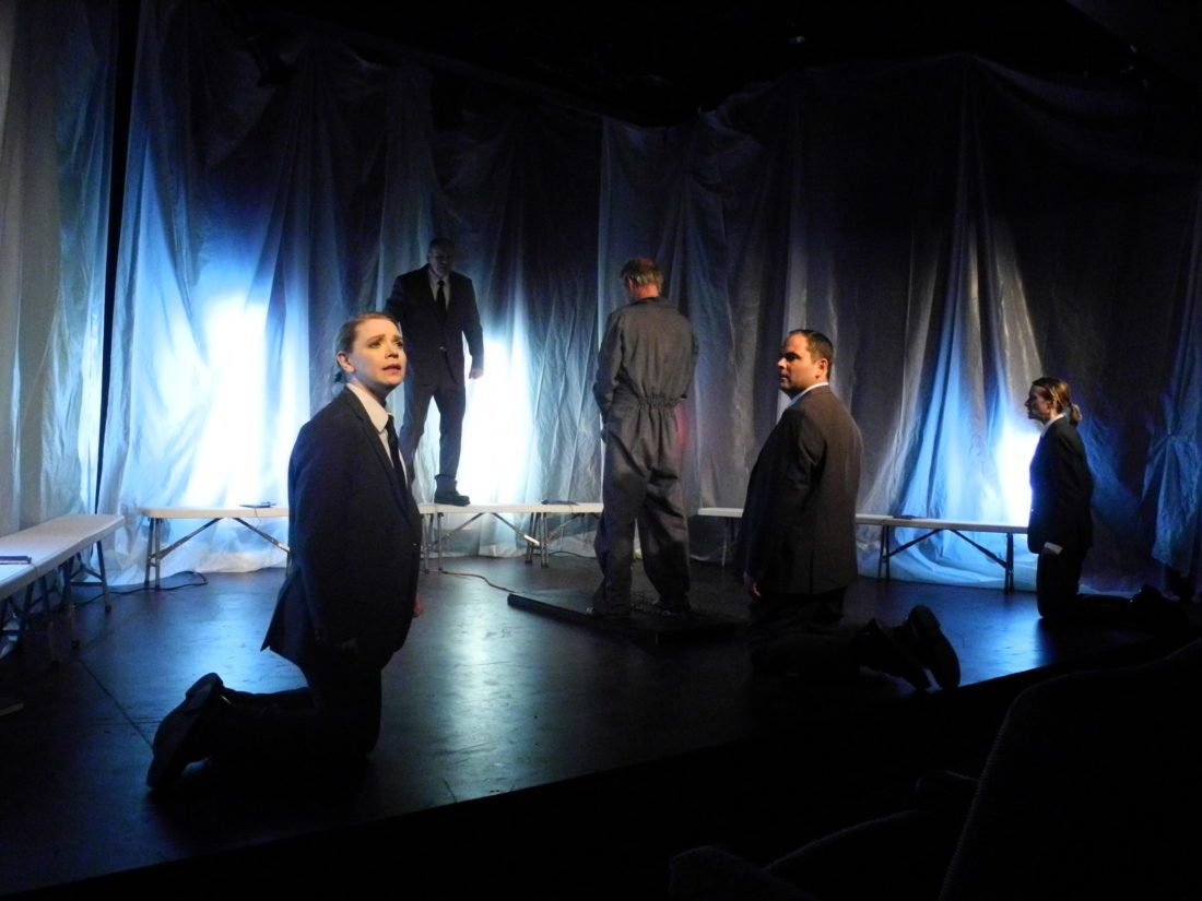 "Pictured from left, Liv Paulson, Terry Kemp, Chris Leifheit, Brendan Gotham and Leslie Dame depict the interrogation of Winston Smith in Pendragon Theatre's ""1984."" (Enterprise photo — Aaron Cerbone)"