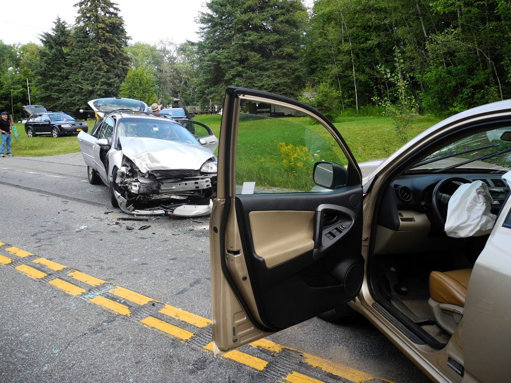 A head-on collision between two cars this afternoon on state Route 86, south of Donnelly's Corners, resulted in the hospitalization of the driver and passenger of one car and the temporary closure of the highway between Route 186 to Trudeau Road. (Enterprise photo — Aaron Cerbone)