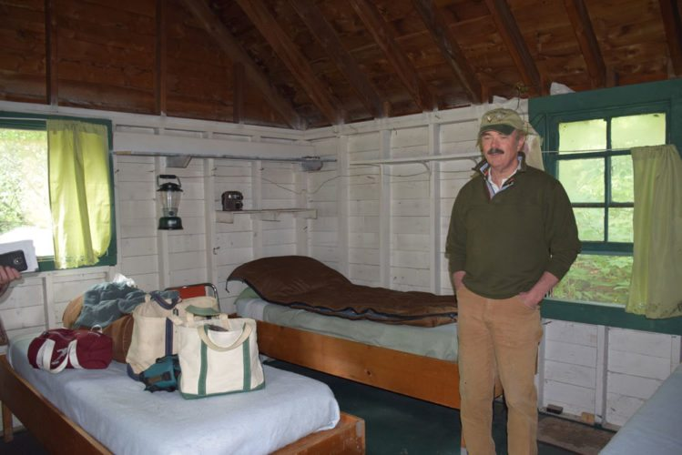 Gooley Club Vice President Donald MacElroy gives a tour of one of the hunting camp's still-furnished bunkhouses Friday in what is now the Essex Chain Primitive Area between Newcomb and Indian Lake. (Enterprise photo — Justin A. Levine)