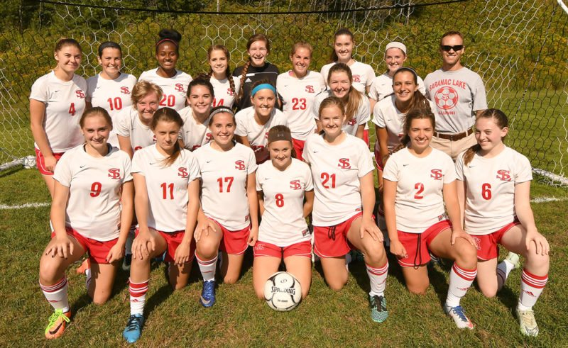 The Saranac Lake girls soccer team poses for a photo Wednesday prior to a scrimmage game against Lake Placid at Schroeter's Field in Saranac Lake. The Red Storm open the season Tuesday on the road against Saranac Central. Look for full previews of other Tri-Lakes fall sports teams in next Friday's Enterprise. (Enterprise photo — Lou Reuter)