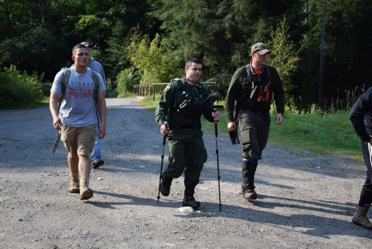 Forest Ranger Adam Baldwin, center, and Search and Rescue of the Northern Adirondacks Training Officer Neilson Snye lead some soldiers from Fort Drum out of the woods Monday morning after a missing hiker had been found. (Enterprise photo -- Justin A. Levine)