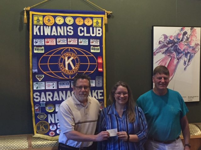 Saranac Lake Kiwanis Secretary Keith Freeman and longtime member Bill Rich,  present a donation check to Aleacia Landon, director of the Saranac Lake Youth Center. (Photo provided)