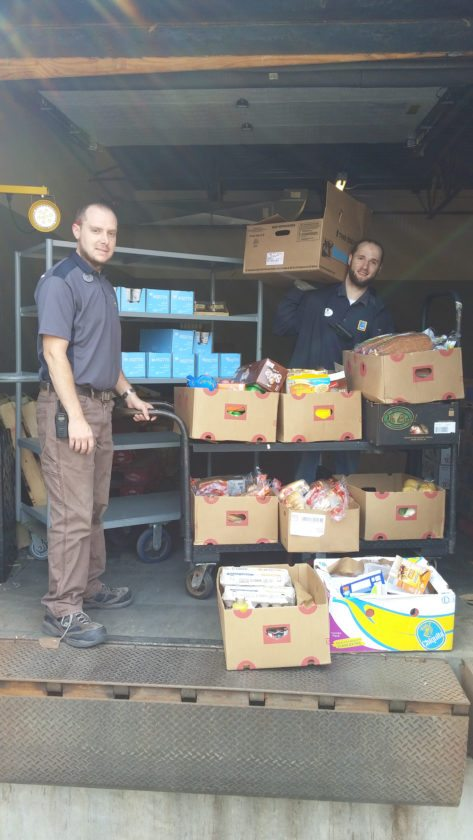 This summer, the Aldi supermarket in Saranac Lake has partnered with the Feed America program and the Regional Food Bank of Albany to donate food to the Community Lunch Box on a weekly basis. The Community Lunch Box provides lunches for anyone in the Saranac Lake area in the St. Luke's Parish Hall on Main Street from 11:30 a.m. to 12:30 p.m. Mondays and Thursdays. Pictured are Zack MacDowell, Saranac Lake Aldi store manager, and Jordan Tabolt. (Photo provided)