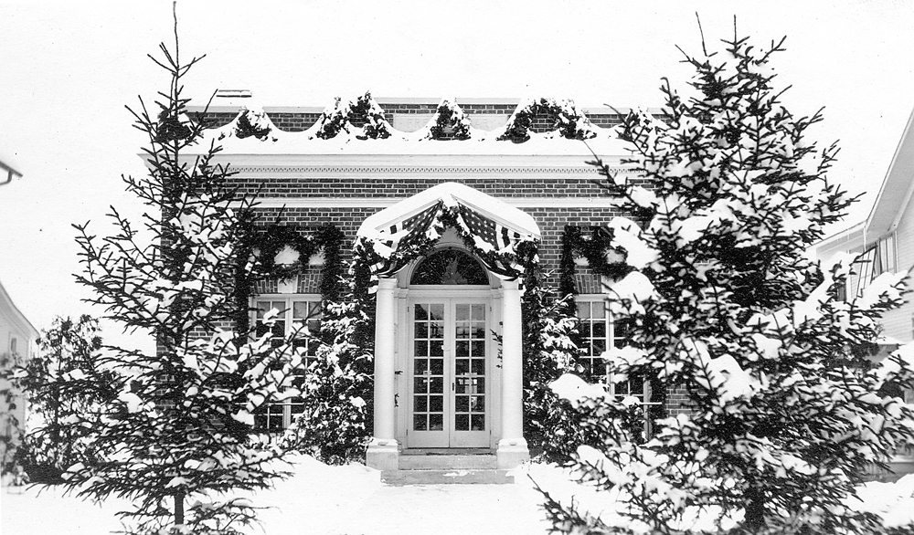 The new library in 1910 decorated for the Saranac Lake Winter Carnival (Photograph #83.836 courtesy Adirondack Collection, SLFL)